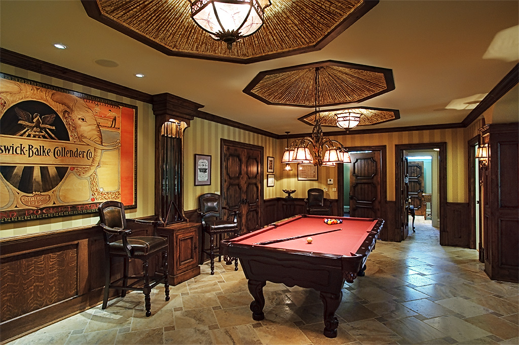 Beautiful wood trimmed room with pool table